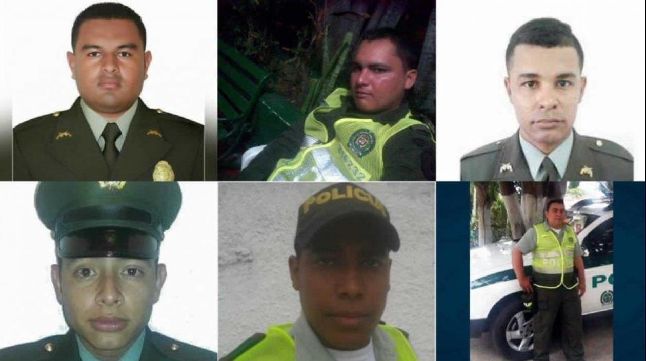 Los rostros de los agentes fallecidos.