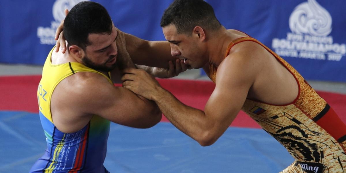 La lucha grecorromana es una de las disciplinas de los Juegos Bolivarianos.