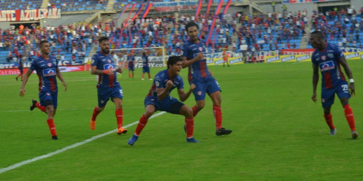 Juan Carlos Pereira celebra su gol contra el Cali.