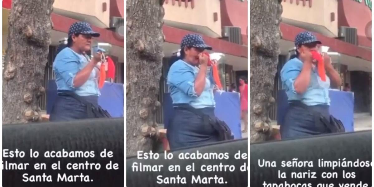La mujer fue captada en la avenida Campo Serrano soplándose la nariz con los tapabocas que vende.