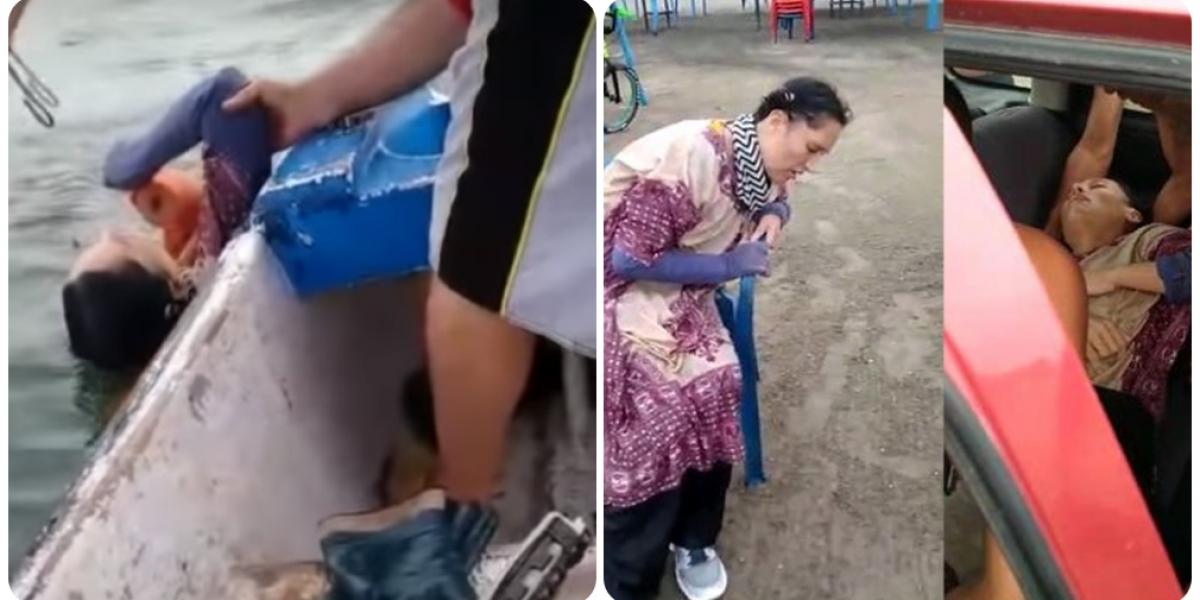 Momentos en que la mujer era rescatada por pescadores de Puerto Colombia.