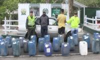 Andrés Felipe Moncada Sánchez  y un menor de edad capturado por contrabando de gasolina.
