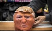 Los ladrones usaban las máscaras de Trump para esconder sus rostros.