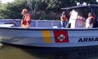 Miembros de la Defensa Civil y la Armada Nacional.