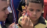 La unimag pintó de colores el rostro de los niños.