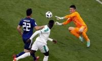 Acción del duelo entre Japón y Senegal.