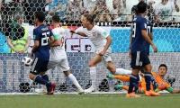 Jugadores de Polonia celebran el gol ante Japón.