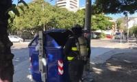 contenedor de basura quemado