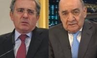 Álvaro Uribe y Yamid Amat.
