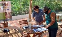 Firma de acuerdos de las familias de la Asociación Unidos por la Recuperación de Puerto Caimán.