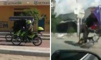 Agente de la Policía chocando a bordo de un bicitaxi