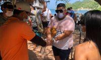 Turistas en playas del Distrito.