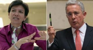 La senadora de la Alianza Verde Claudia López y el senador Álvaro Uribe.