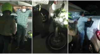 Momento en que el hombre señalado de no pagar una botella de whisky es abordado por la Policía.