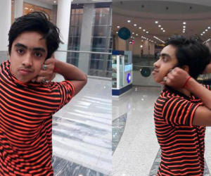 Niño que gira su cabeza 180 grados
