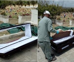 Trabajadores de la funeraria retiran el ataúd averiado.