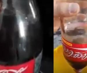 Demostración del hombre con la botella de Coca- Cola.