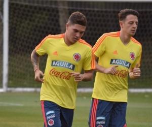 Juan Fernando Quintero y Santiago Arias entrenando en Italia.